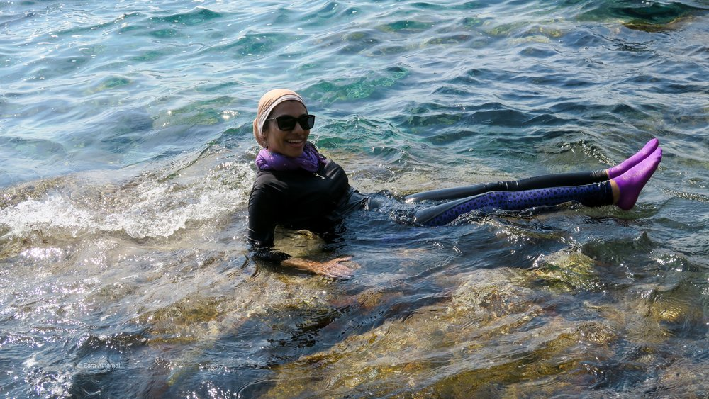 Improvised Modest Swimsuit: Water proof leggings and long sleeves   top + scarves + Waterproof socks