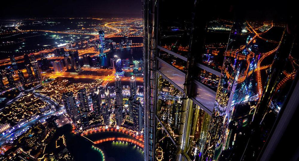 Dubai at night as seen from Burj Khalifa - A World to Travel.jpg