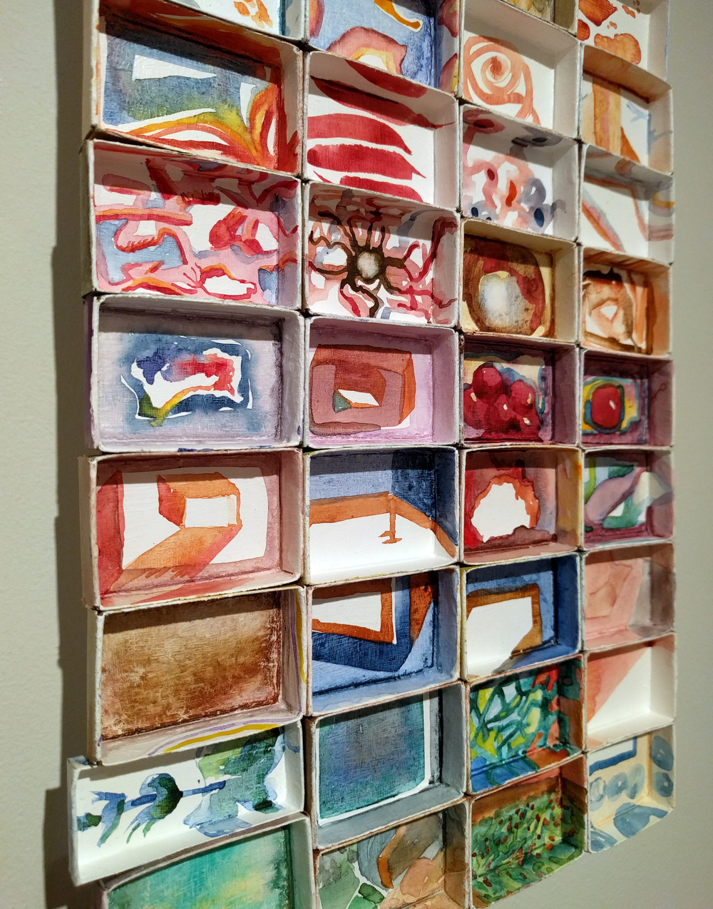 "Victoria Hibbs, ""Safe Place"" 2015-2016 (detail) watercolor on matchboxes, 9 x 14 in."