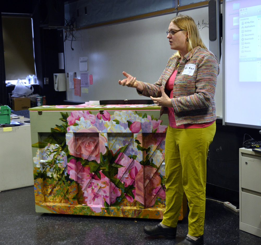 In my short presentation telling the students how the piano came to be, I explained   how I used my sister's funeral bouquet as the imagery for a   beautiful painted instrument, transforming grief into joy.