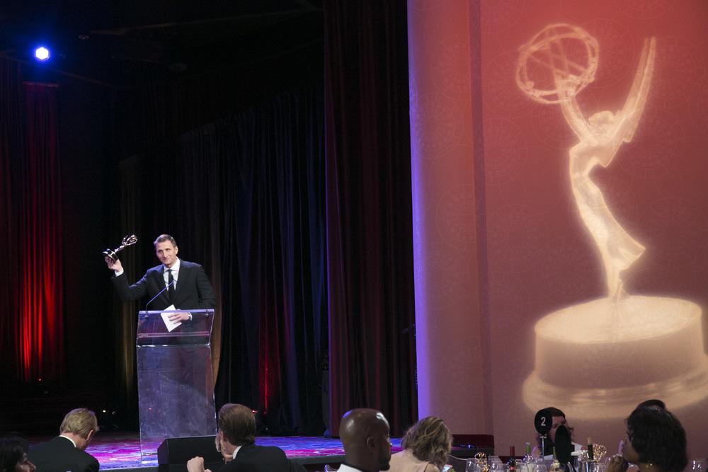 RGTV Founder/Executive Producer Roman Gackowski accepting an award.