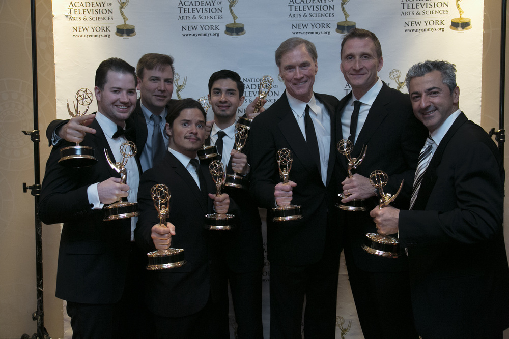Some of the RGTV team with the 10 EMMY awards.  From L to R (Dan Galway, Senior Producer;   Lee Umphred, Editor & Co-Founder of Media 2; Filipe DeAndrade, Photographer; John Ibarra, Director of Technical Operations; Fran Healy, Host & Executive Producer; Roman Gackowski, Founder & Executive Producer; Chris Kostianis, Director of Photography.)