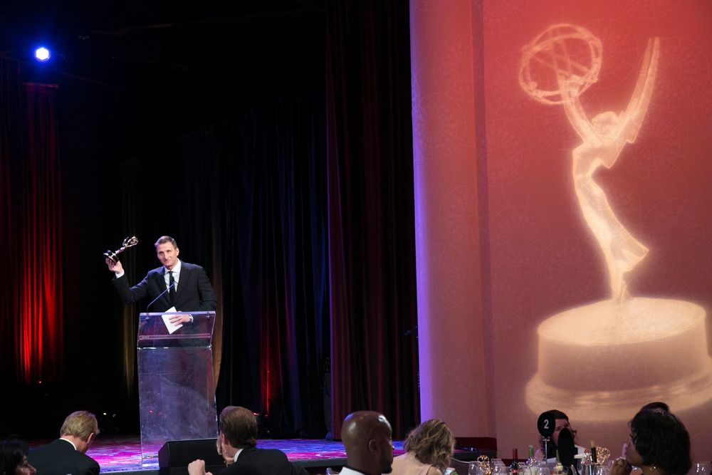 Founder and Executive Producer Roman Gackowski accepting an Emmy.