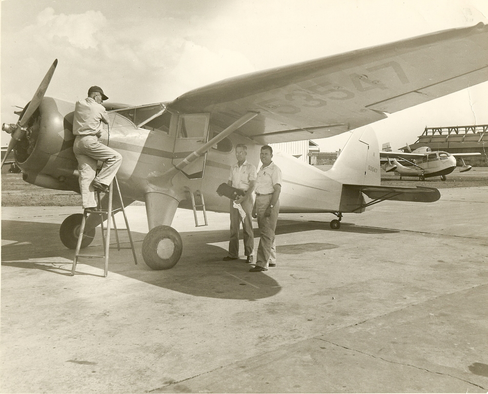 C. Holbert and two guys by prop plane.jpg