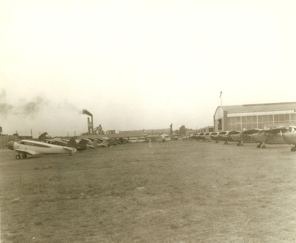 old prop planes lined up on grass.jpg