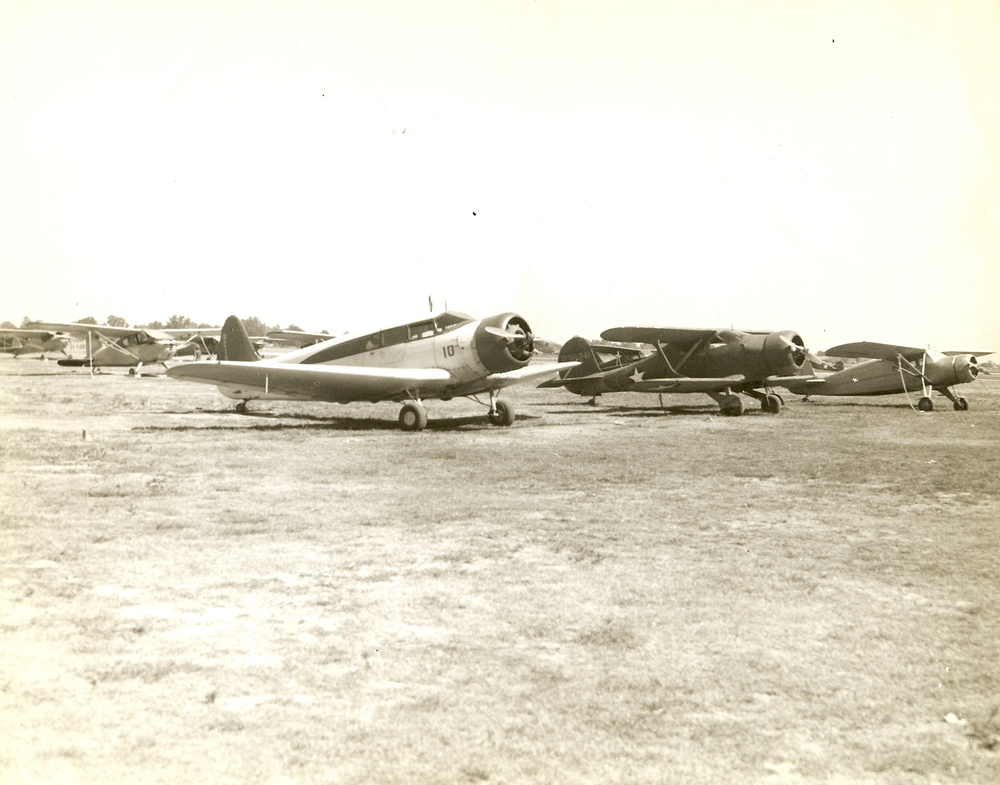 old propr planes on grass.jpg