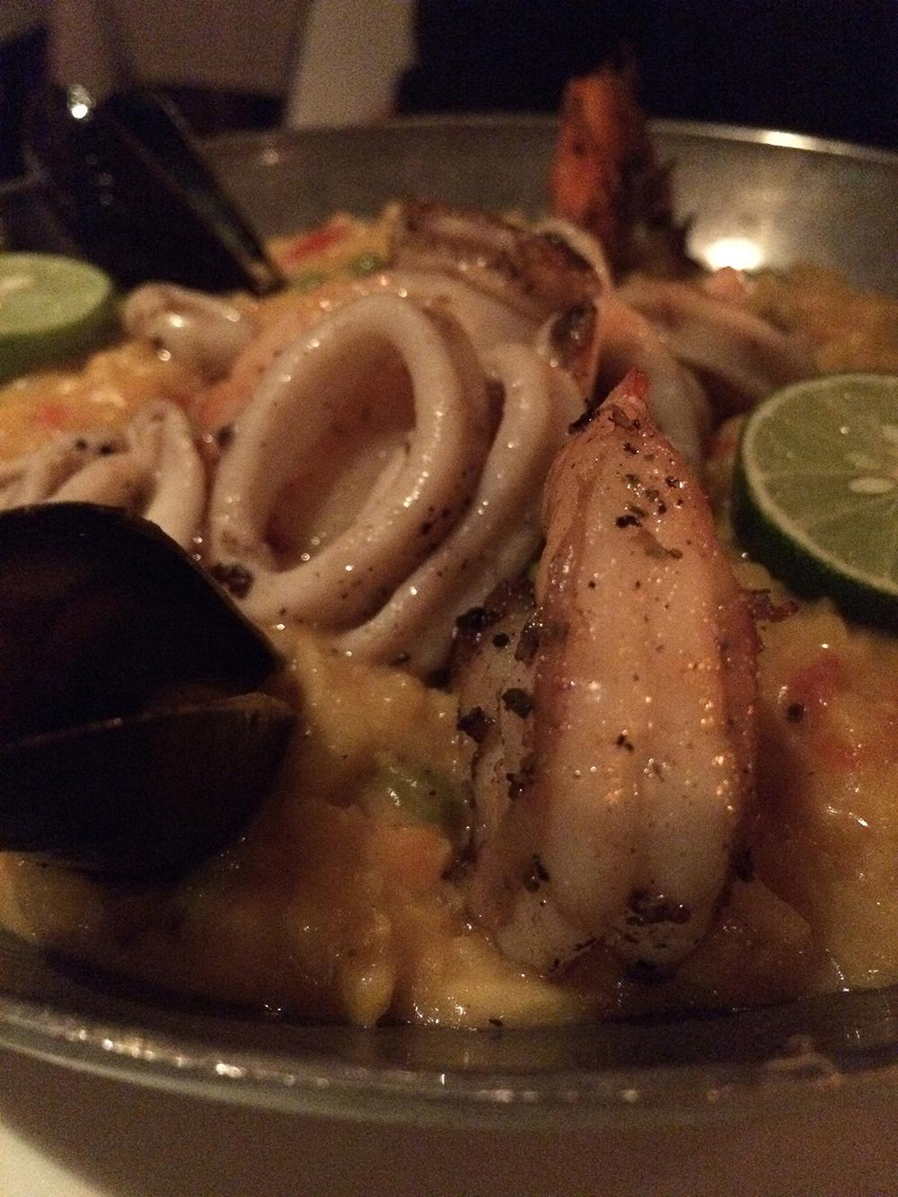 Paella del mar, black tiger shrimp, sea scallop, calamari, mussels, saffron rice with chicken, green pea, red bell pepper, artichoke, saffron aioli, pimenton and oregano.