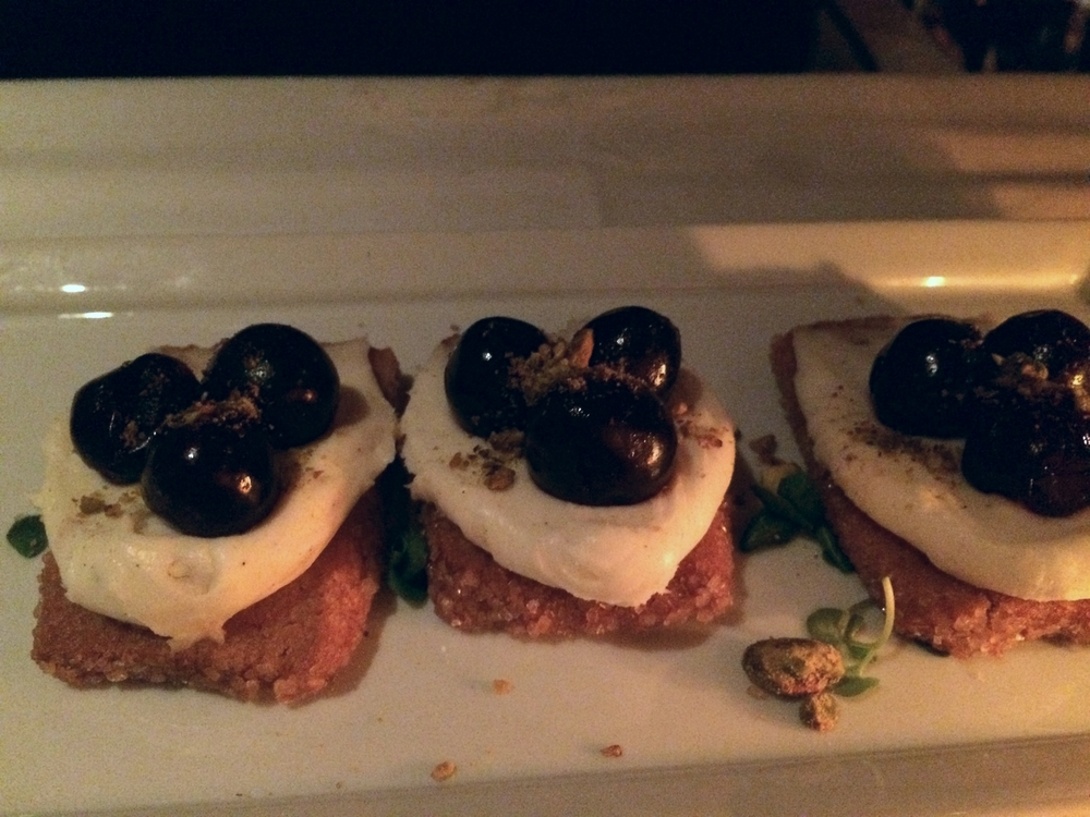 """Dessert """"crostini"""", amarena cherry, mascapone, pistachio shortbread with micro-basil."""