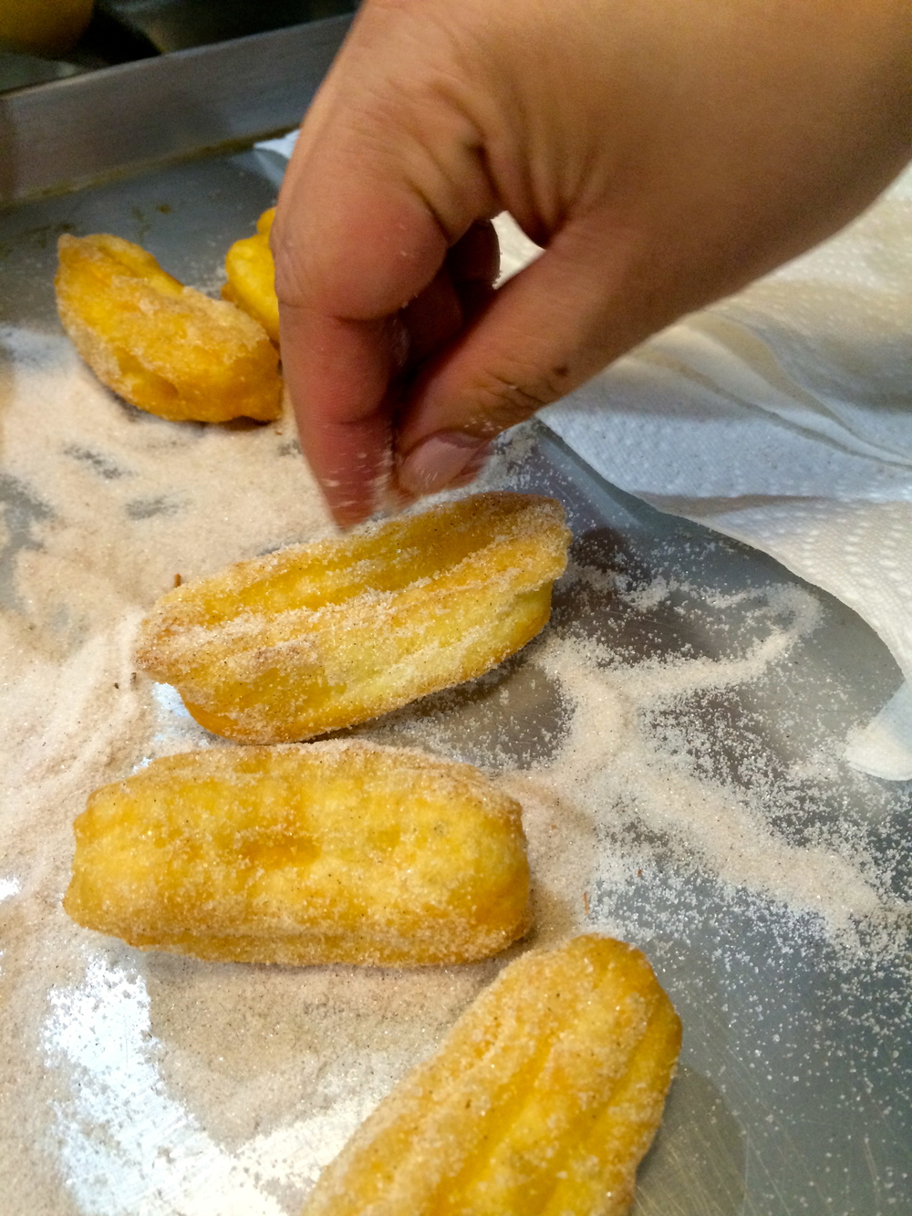 Churros sprinkled with cinnamon sugar.