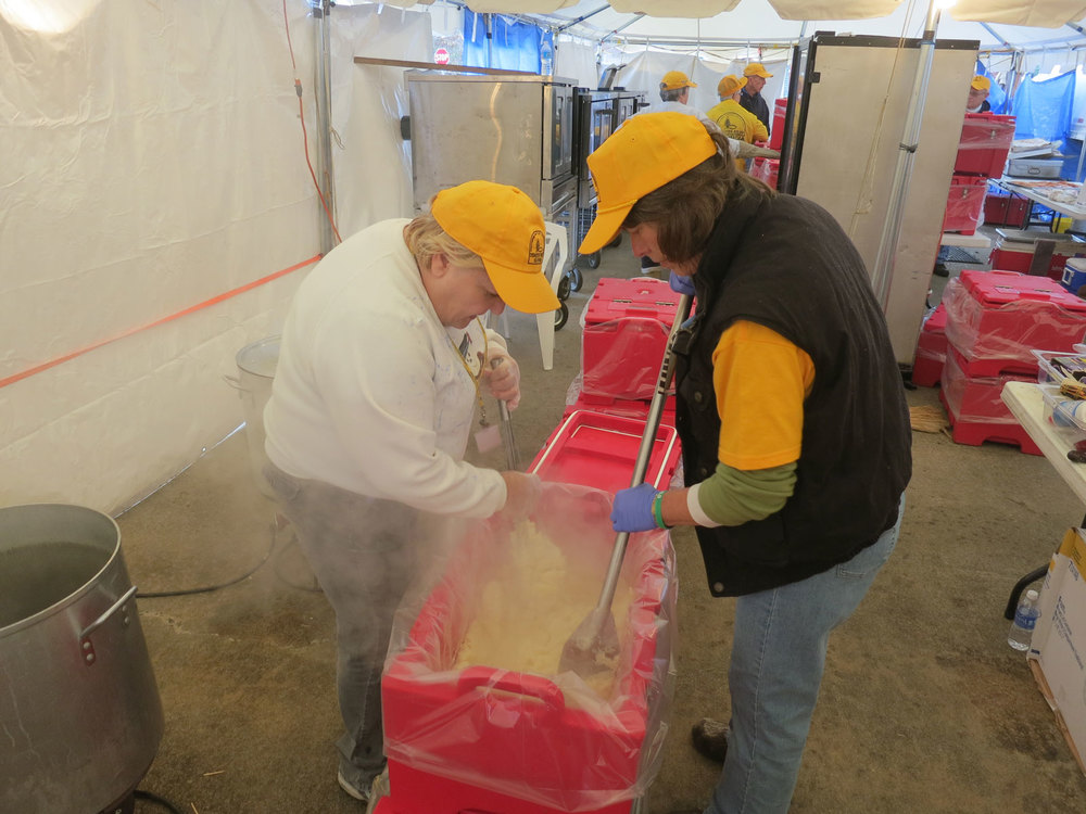 These volunteers are a long way from their families in North Carolina and are seen here preparing one order of mashed potatoes, enough for 100 off-site meals.  The Waretown kitchen, K-3, was a fully inspected commercial kitchen set up in temporary tents and these workers will not get home for the Holiday.  The day begins by loading the ERVs with enough food to serve 300 people each and the day ends at dusk with cleaning everything for use again tomorrow.