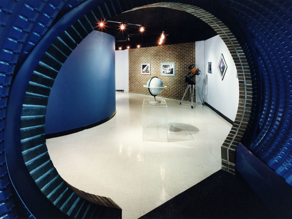 The floor plan is designed in a series of orbits circulating visitors through the lobby, tunnel, museum, and planetarium.