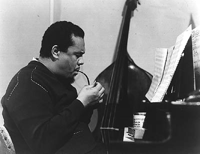 Mingus Enjoying A Smoke. Photo Credit Unknown.