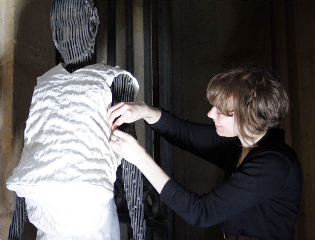 sewing garments on a mannequin