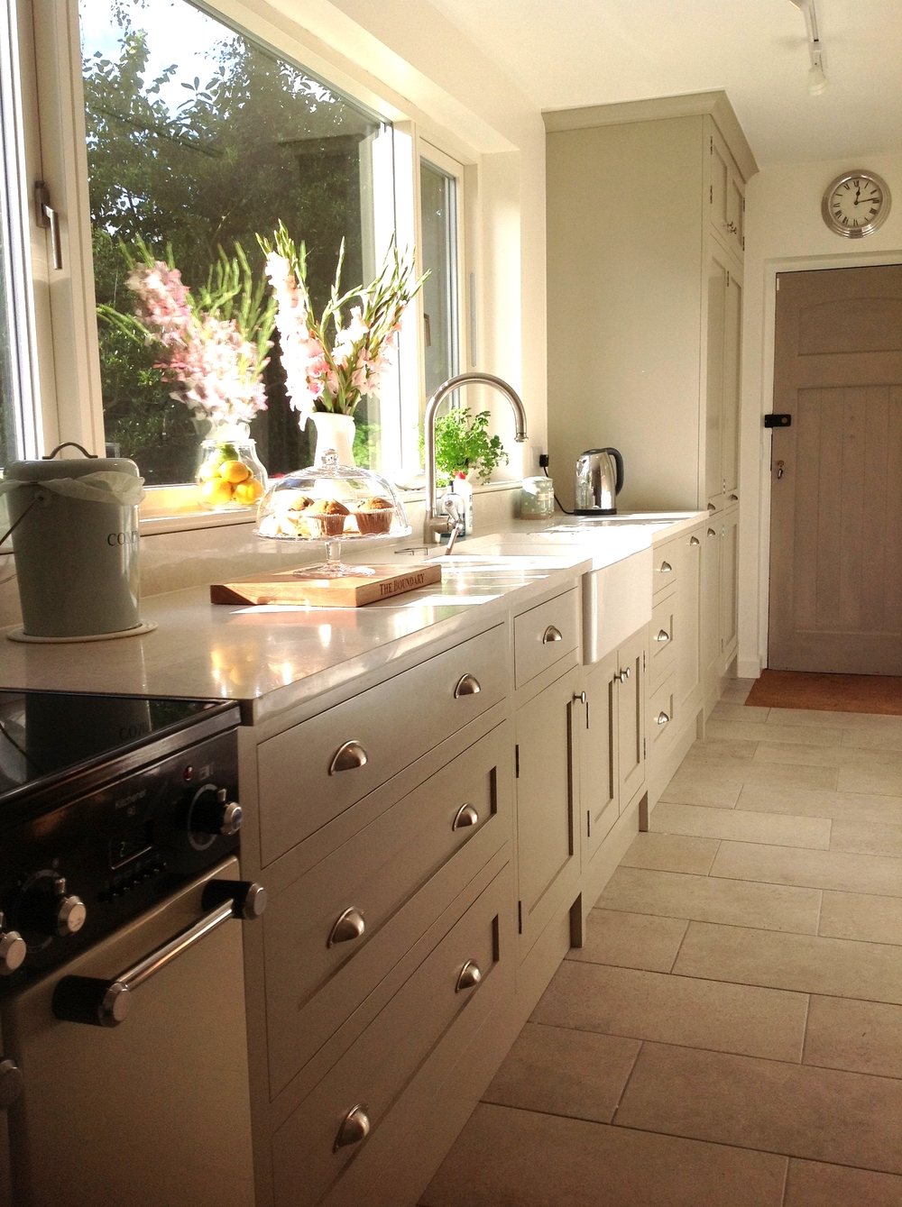The Boundary   A traditional Shaker-style kitchen.  Runner-up in the Marion John Kitchen Design Awards, The Boundary is a beautiful, bespoke kitchen. Complementing the large garden view, bringing outside inside with its earthy colours and subtlety, The Boundary is worthy of all its credit.   Cabinetry - hand-painted in Farrow & Ball's French Gray: £9000 installed.    Worktops - Quartz Arenastone Grigio Venato, with upstands, cut-outs and grooves: £2500 installed.    Additions: double-bowl Belfast sink, pull-out larder and Smeg slimline extractor and extractor housing: £1850 approx. installed.