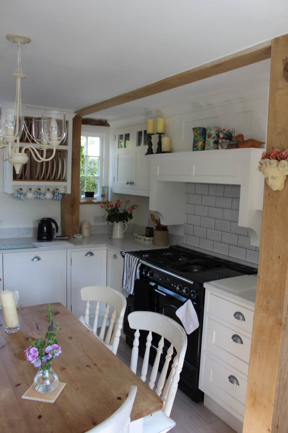 Jasmine Cottage   A classical Shaker-style kitchen.  The beauty of Jasmine Cottage's kitchen is where tradition and 'country' meet chic and elegant. An English Shaker-style, painted off-white kitchen, creates the illusion of space within the cottage's low ceilings and oak beams; and, the interiors of the cupboards and bespoke plate-rack are finished in matching English oak.   Cabinetry - finished in Farrow & Ball's Pointing: £11500 installed.    Worktops - stone: £2500 approx. installed.    Additions: magic corners, Villroy & Bock double sink, stainless steel pull-out recycling units: £1500 approx. installed.
