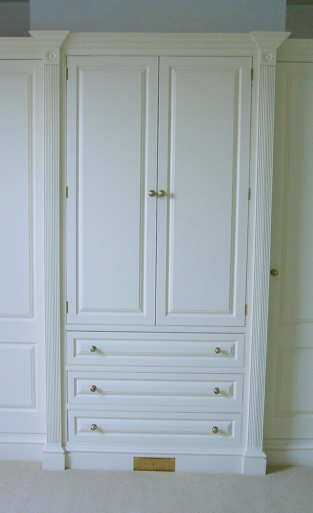 Fitted Wardrobes   Featured above are custom-made double wardrobes finished, paintedfinish in Farrow and Ball's New White and completed withtraditional knob handles and features.    From £1750.