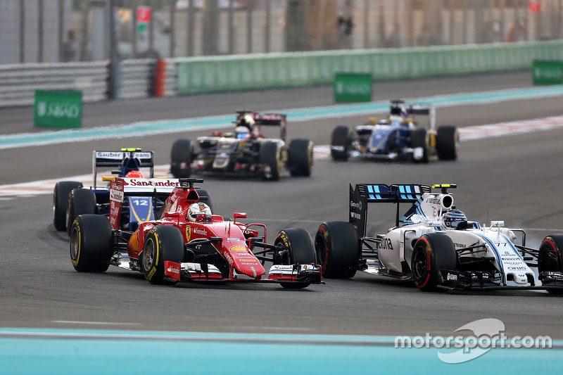 f1-abu-dhabi-gp-2015-sebastian-vettel-scuderia-ferrari-and-valtteri-bottas-williams-f1-tea.jpg