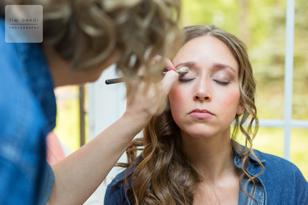 Natural window light fills the room as Kelsey gets her makeup finished up.