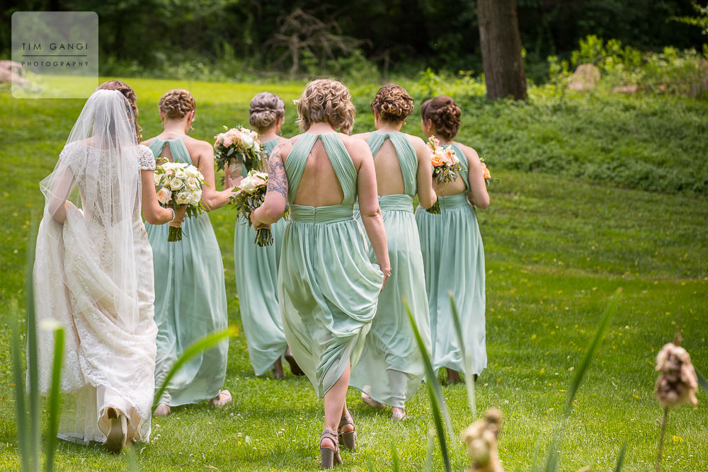 These mint bridesmaids dresses match the greenery of Bittersweet farm perfectly.