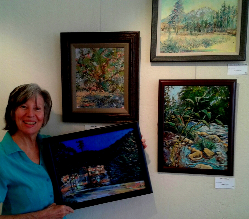 """Petty holds """"Night Yard,"""" above """"Sunset Oaks,"""" """"Julien Ranch Squaw Creek,"""" and """"River Willows."""""""