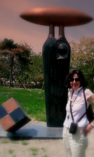Cher standing with fav sculpture