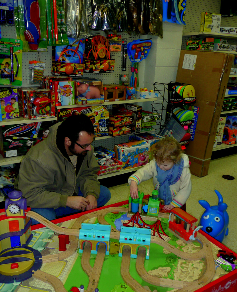 Eugene toy store with toy train, James and Maddie