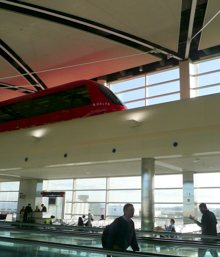 This red monorail travels the length of the Delta terminal on an interior, elevated track.