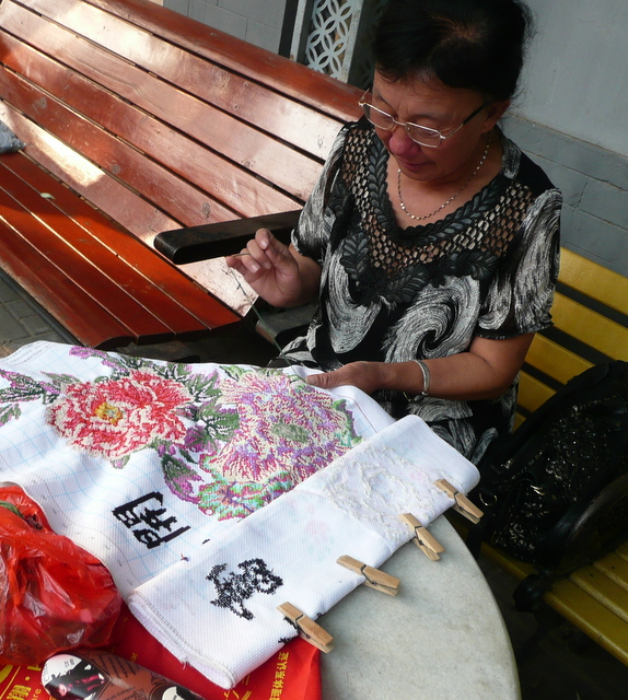 A hutong resident with her needlepoint hobby.