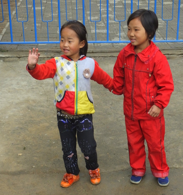 Girls in new clothes at end of harvest at the Chongsan Co-operative Farm in Kangso County, photo by D E