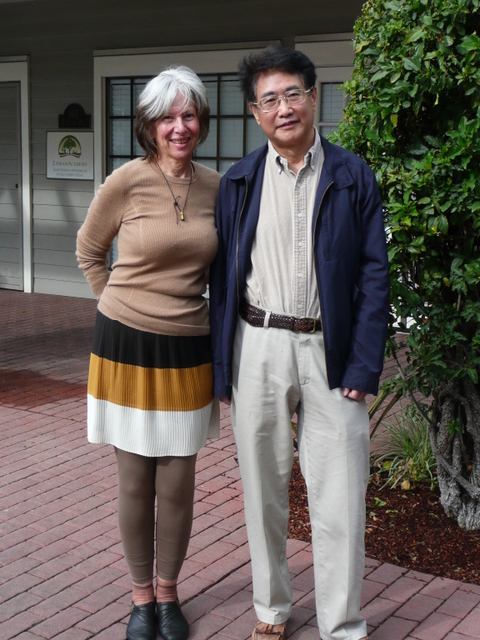 Sha Li and Qiu Xiaolong pose for selfies at Starbucks in Palo Alto, California.