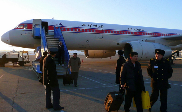 Excerpt from   Wounds  : When Mai enters DPRK, it's clear and fifty-five degrees Fahrenheit or twelve degrees Celsius at 19:09 Beijing time or 8:10PM Pyongyang time. The handful of passengers disembarks from the front of the  Russian Ilyushin-62 jet  and exits down the ramp stairs. Mai turns around on the tarmac to take a picture before entering the low, concrete building that is the terminal.