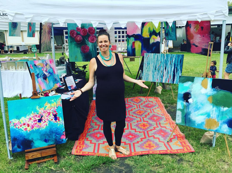 Alita at the markets selling her work. Look how gorgeous she is with that belly!