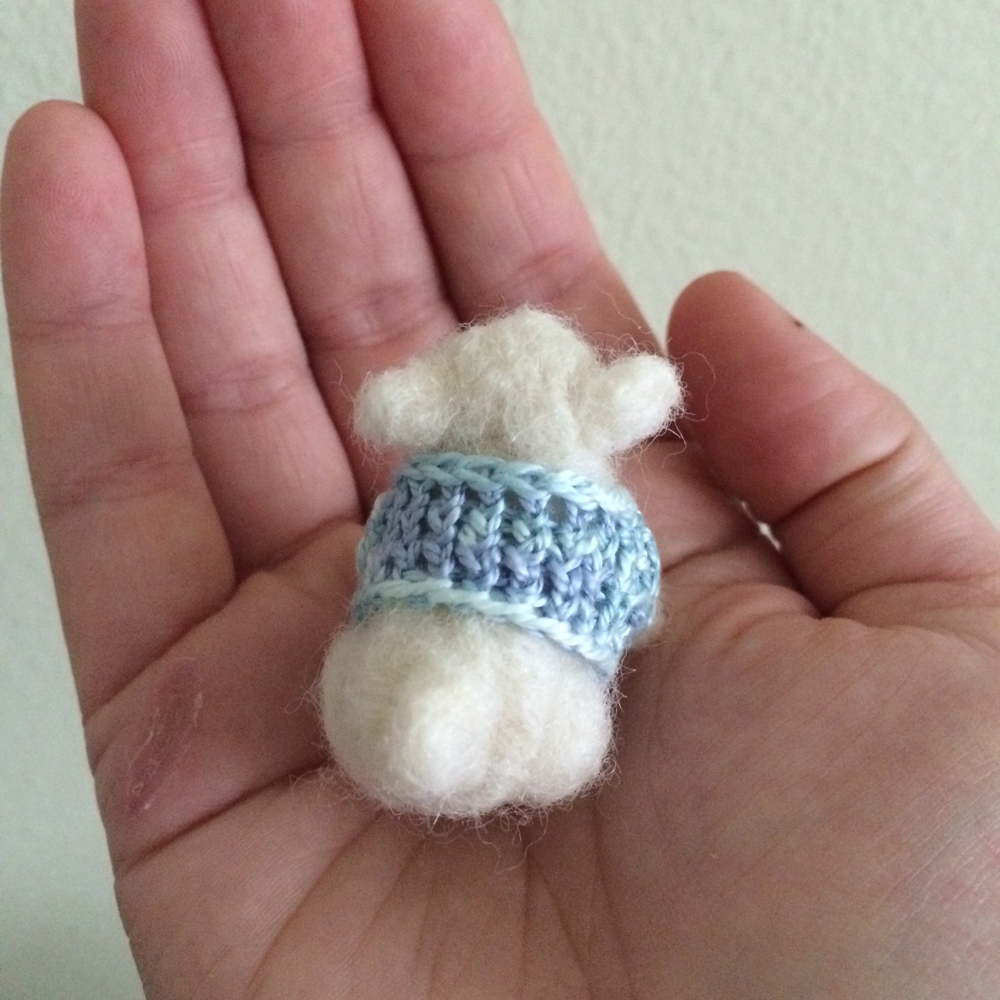 Needle felted pug with miniature sweater