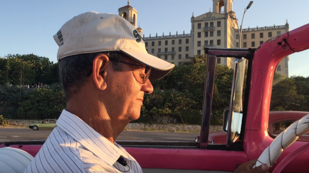 Mi amigo, Gustavo, driving us in the pink ford convertible