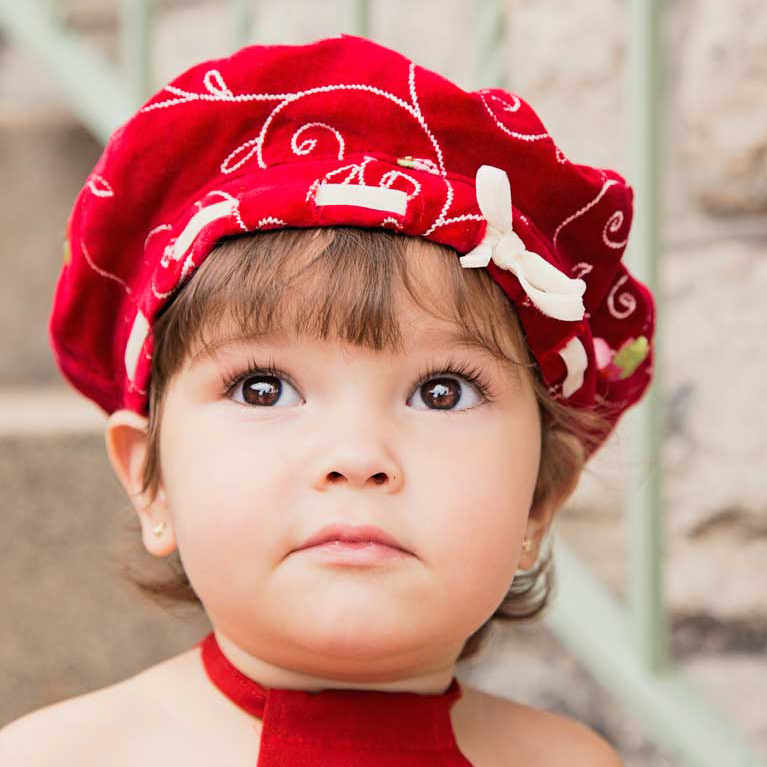 little-girl-red-hat-sparkly-eyes-park-knoxville.jpg