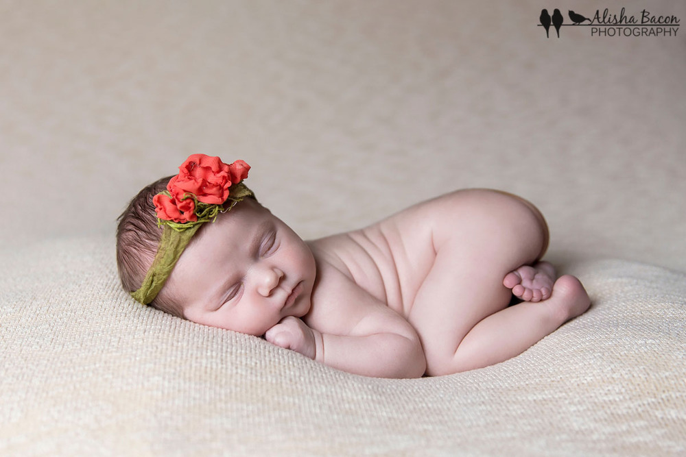 Newborn in poppy tieback