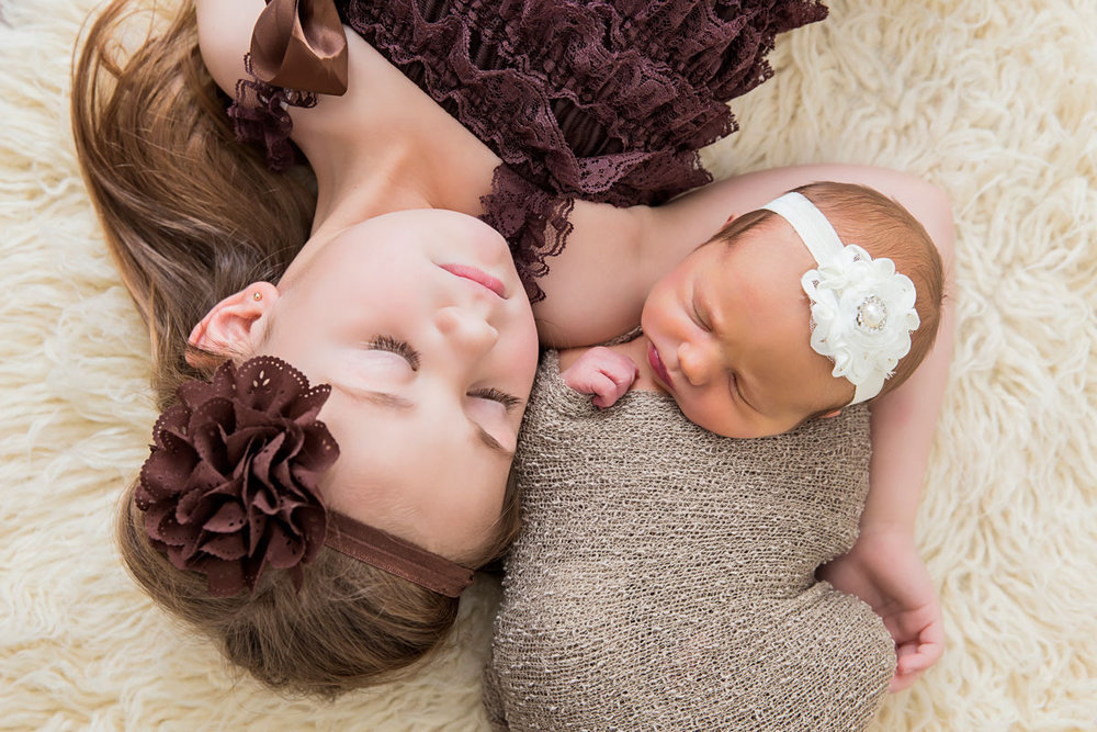 Newborn and sister