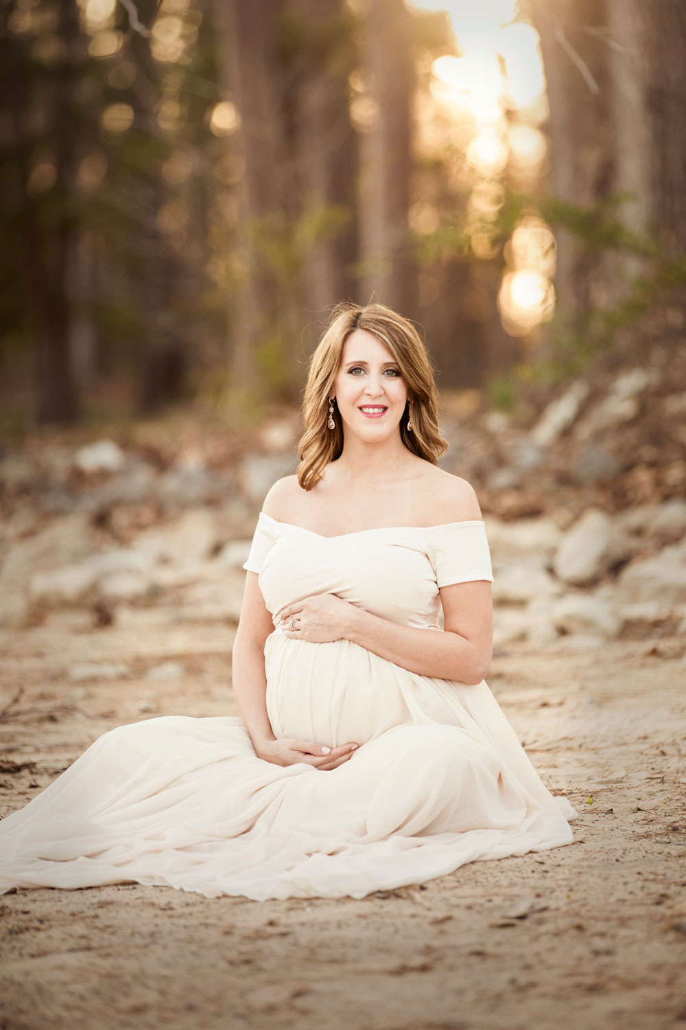 Sunset maternity portrait in chiffon maternity gown.