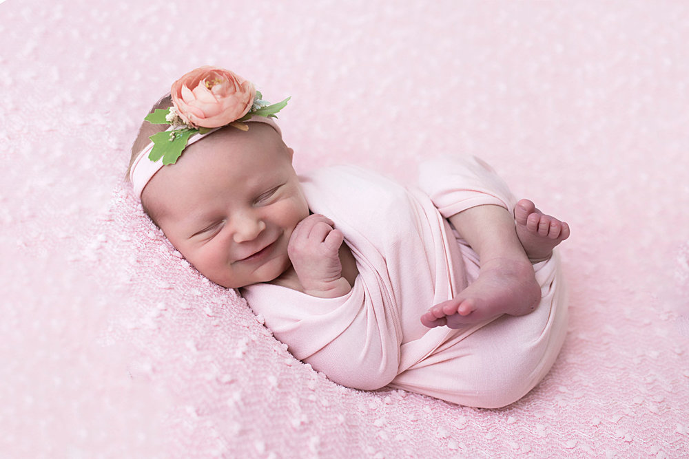 Knoxville-newborn-photographer-smiling-baby-on-pink.jpg