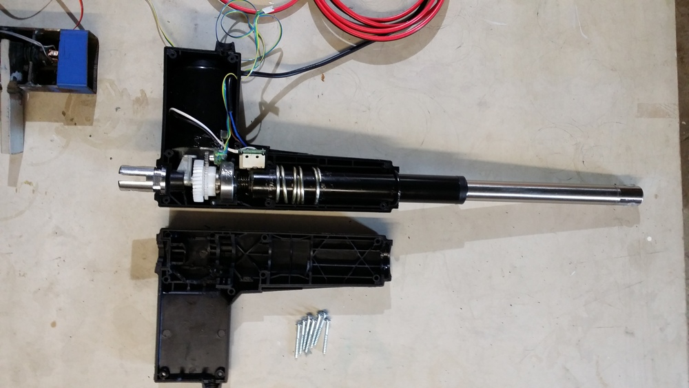 Linear actuator opened to insert rotary encoder and gears