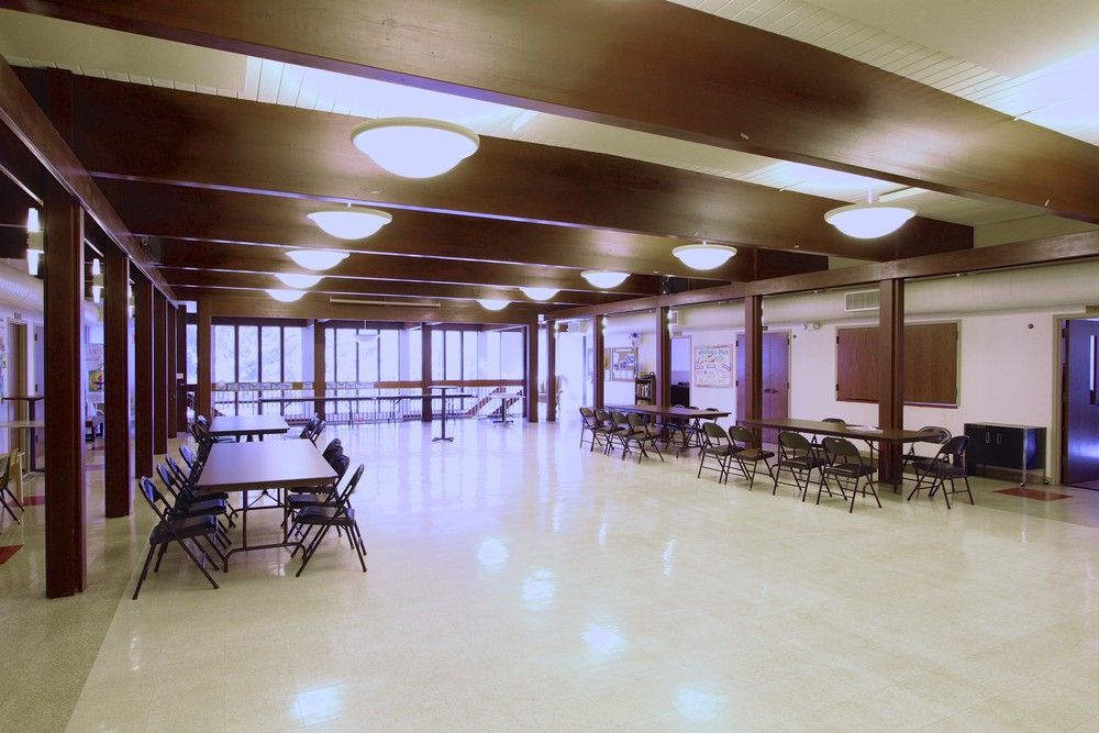 A view of the spacious Fellowship Hall looking toward the beautiful wall of windows to the East.
