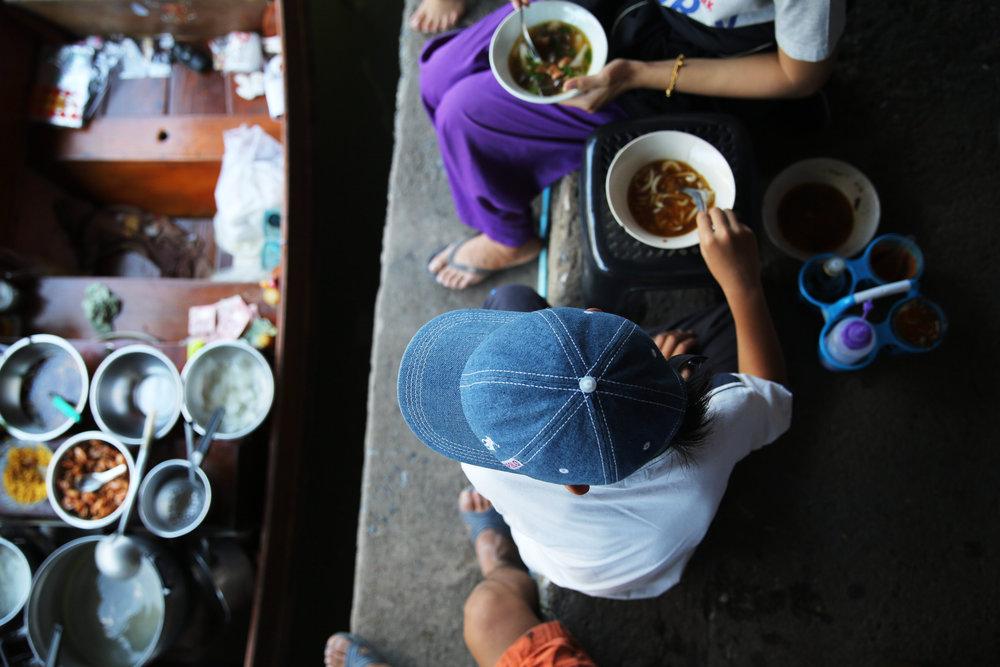 damnoen-saduak-floating-market-boy-soup-gaze.jpg