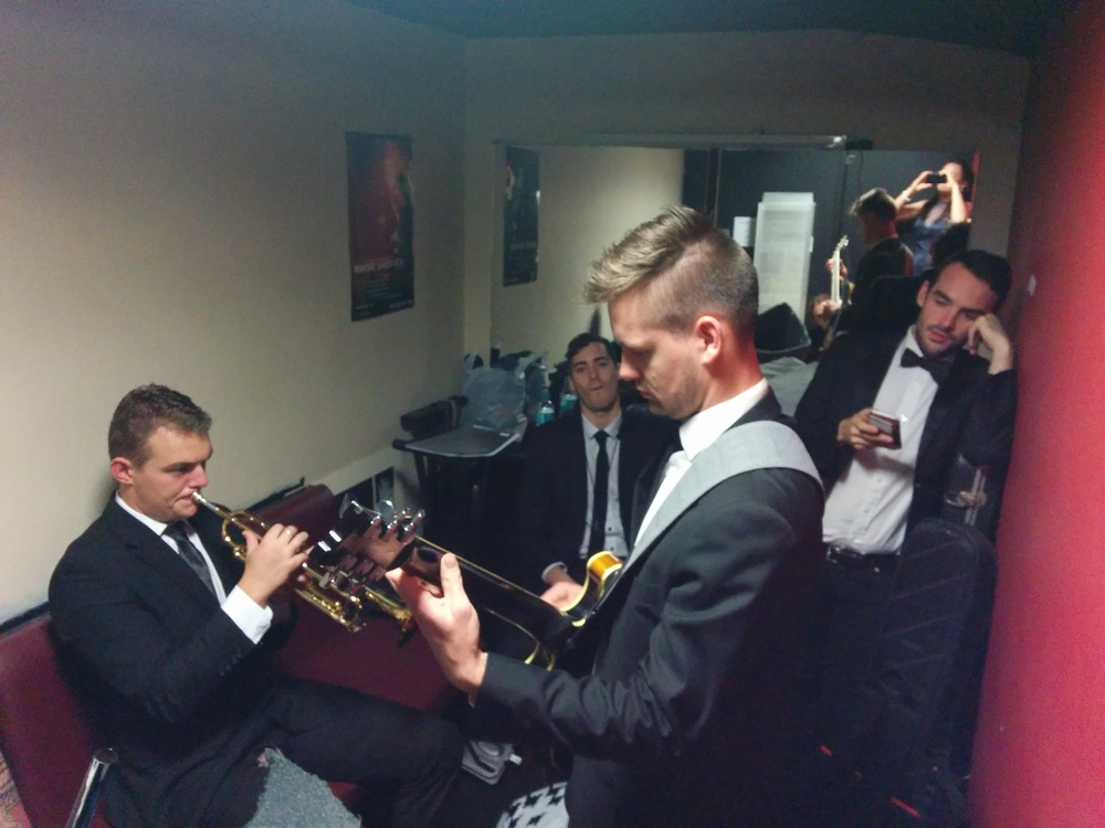 Band warming up backstage...