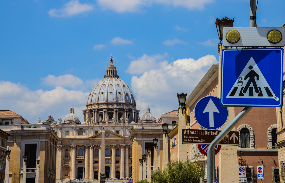 The Vatican City is a landlocked urban enclave, surrounded by the city of Rome, it is the smallest intertnationally recognized independent state in the world by both area and population.