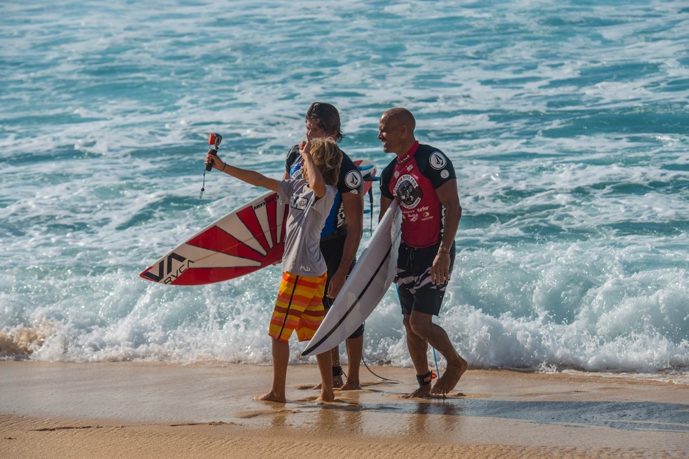 This lucky kid Getting a selfie with Kelly Slater and Bruce Irons after the final.