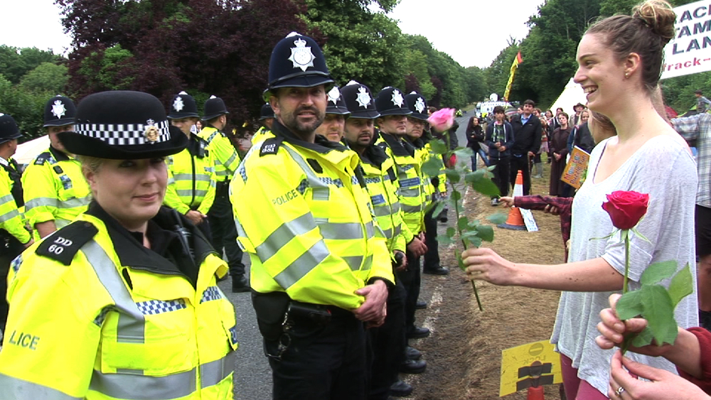 Girls offering roses to policeman at anti tracking demo