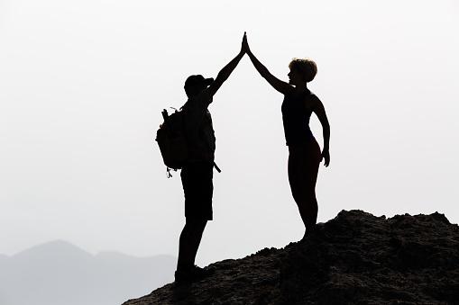 couple-hiking-celebrating.jpg