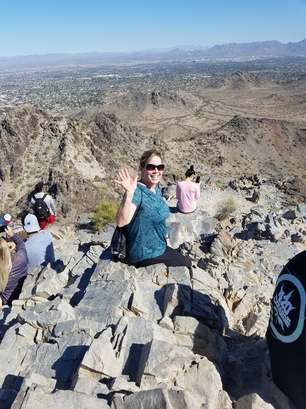 Erin top of piestewa waving.jpg