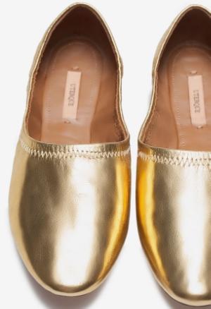 gold ballerinas