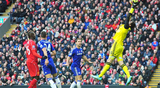 Courtois demonstrates his ability in the air under a high ball, using his tall frame to catch it comfortably.